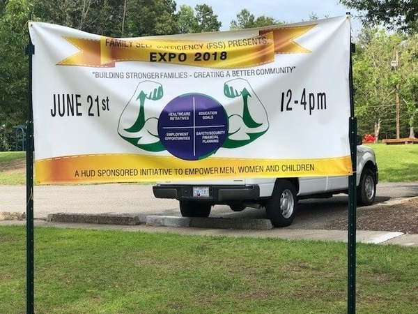 Large white banner for the Family Self Sufficiency Expo